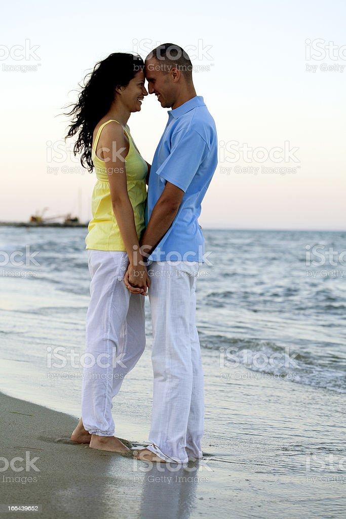 romantic couple at beach stock photo
