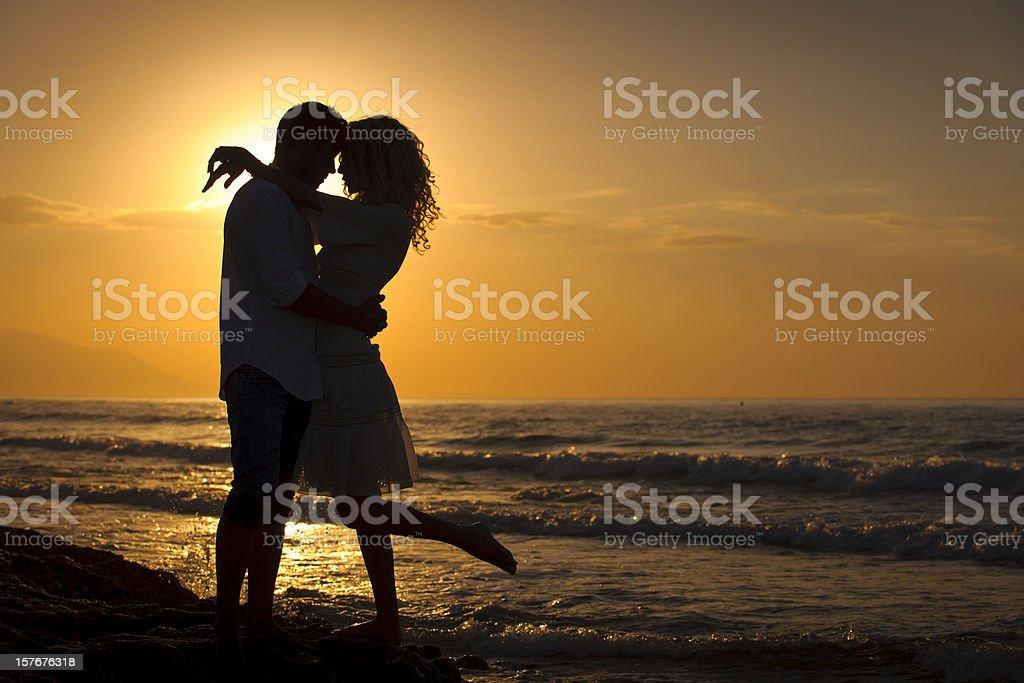 Romantic Couple at Sunset stock photo