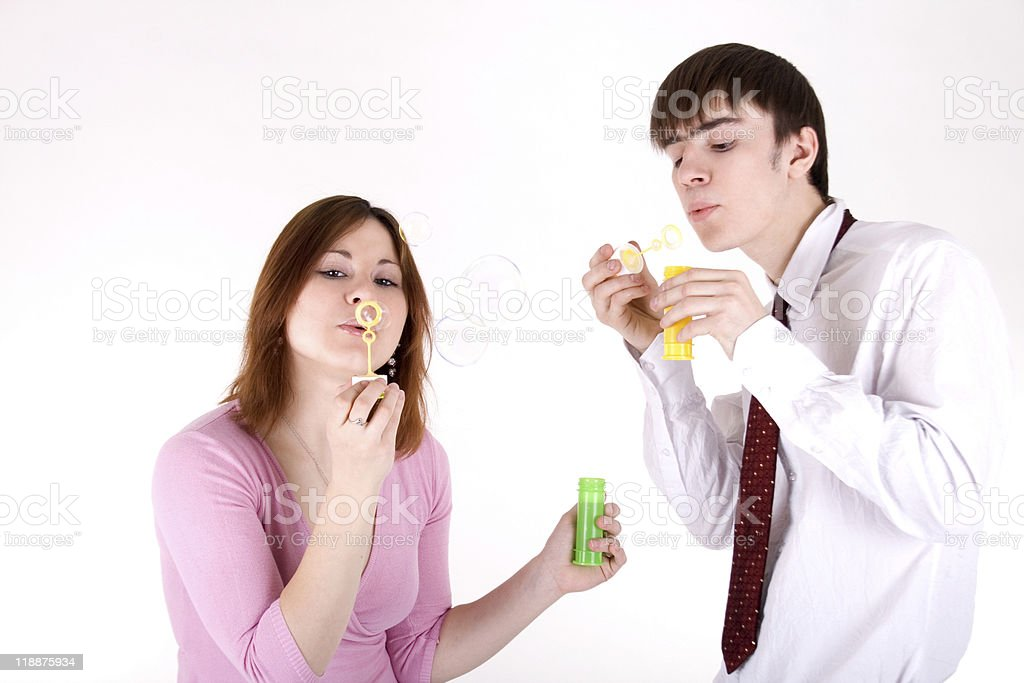 Romantic couple blowing soap bubbles royalty-free stock photo
