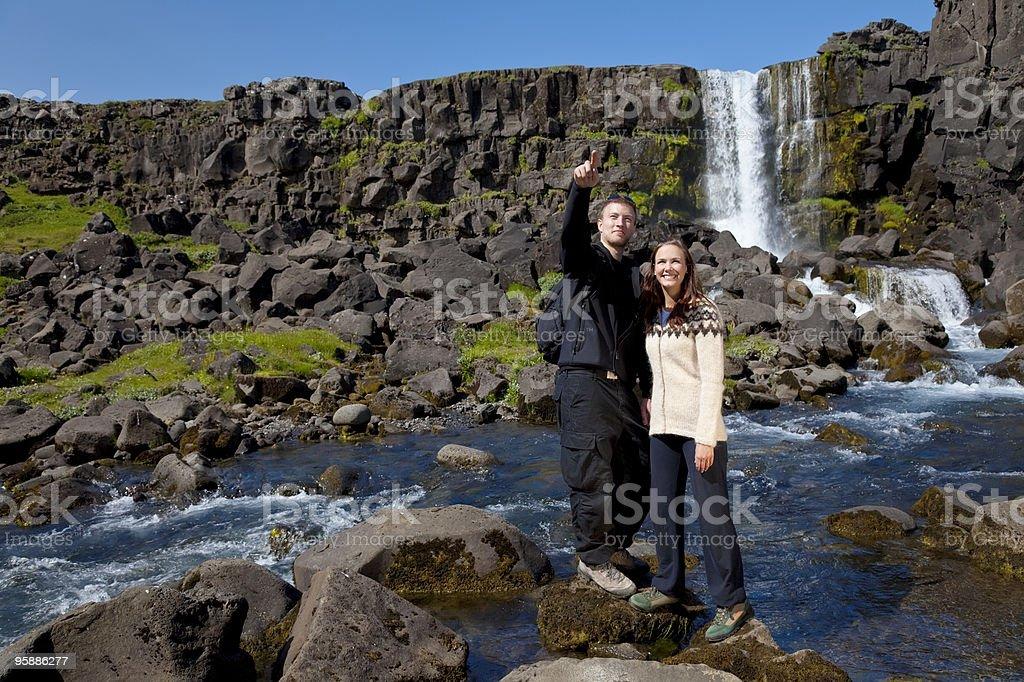 Romantic Couple By a Scandinavian Waterfall royalty-free stock photo