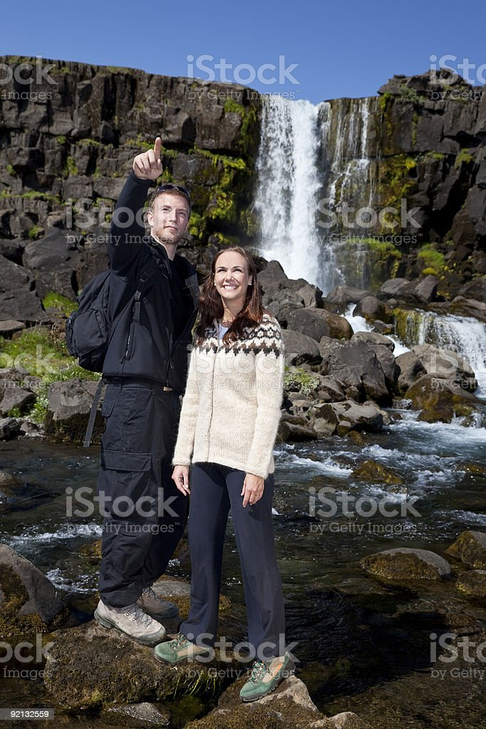 Romantic Couple By a Waterfall royalty-free stock photo