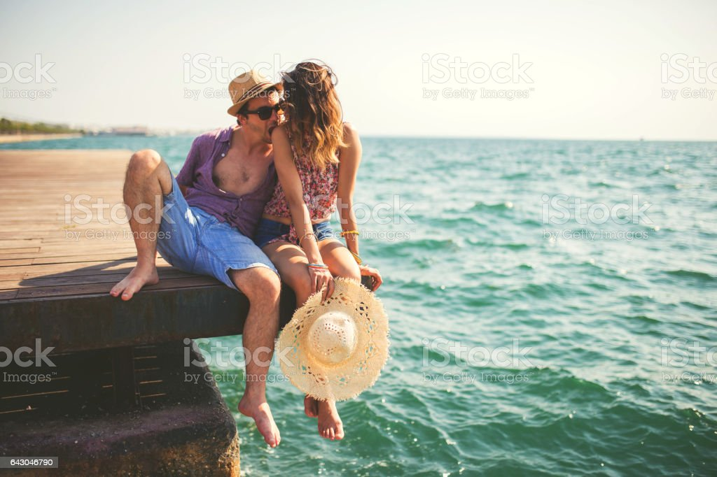 Romantic couple by the sea stock photo