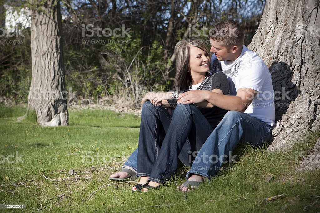 Romantic Couple Dressed Casual Snuggling Outdoors royalty-free stock photo