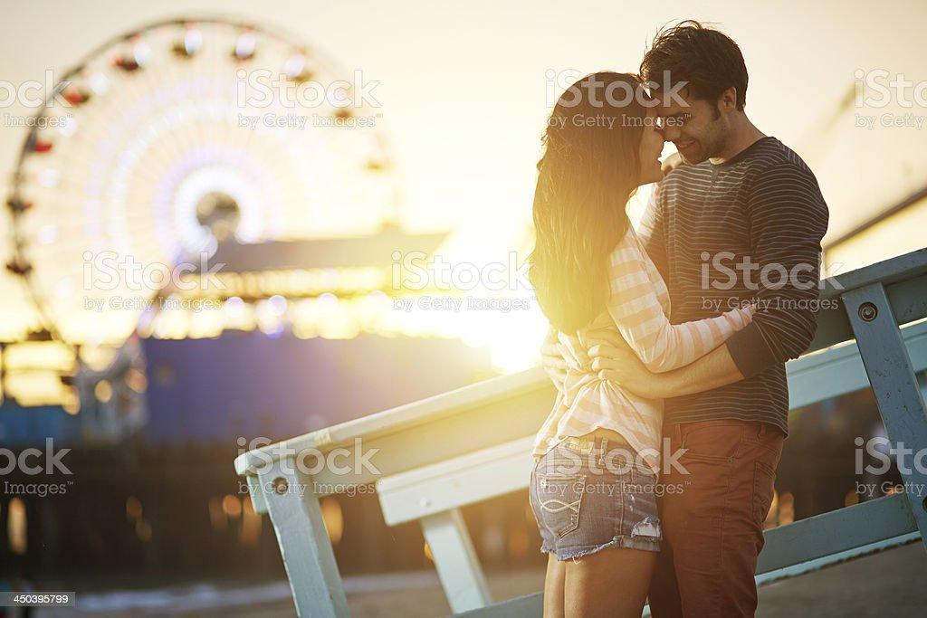 romantic couple embracing  at sunset stock photo