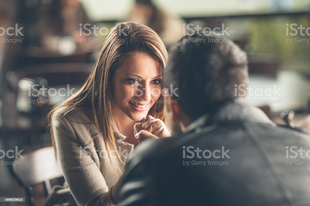 Romantic couple flirting at the bar stock photo
