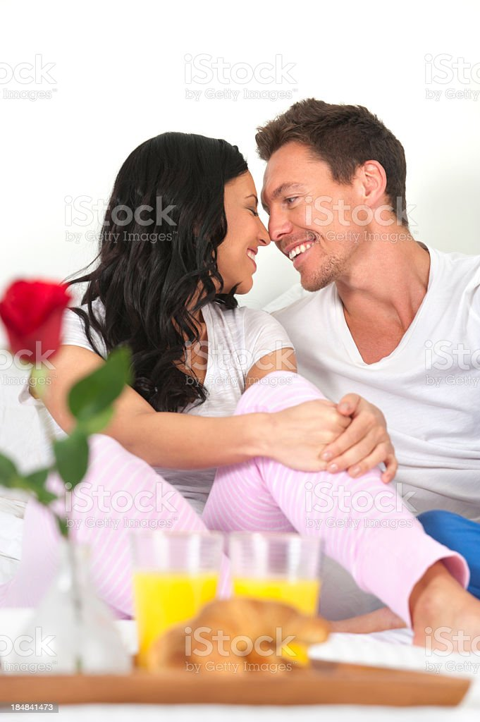 Romantic couple having breakfast in bed royalty-free stock photo