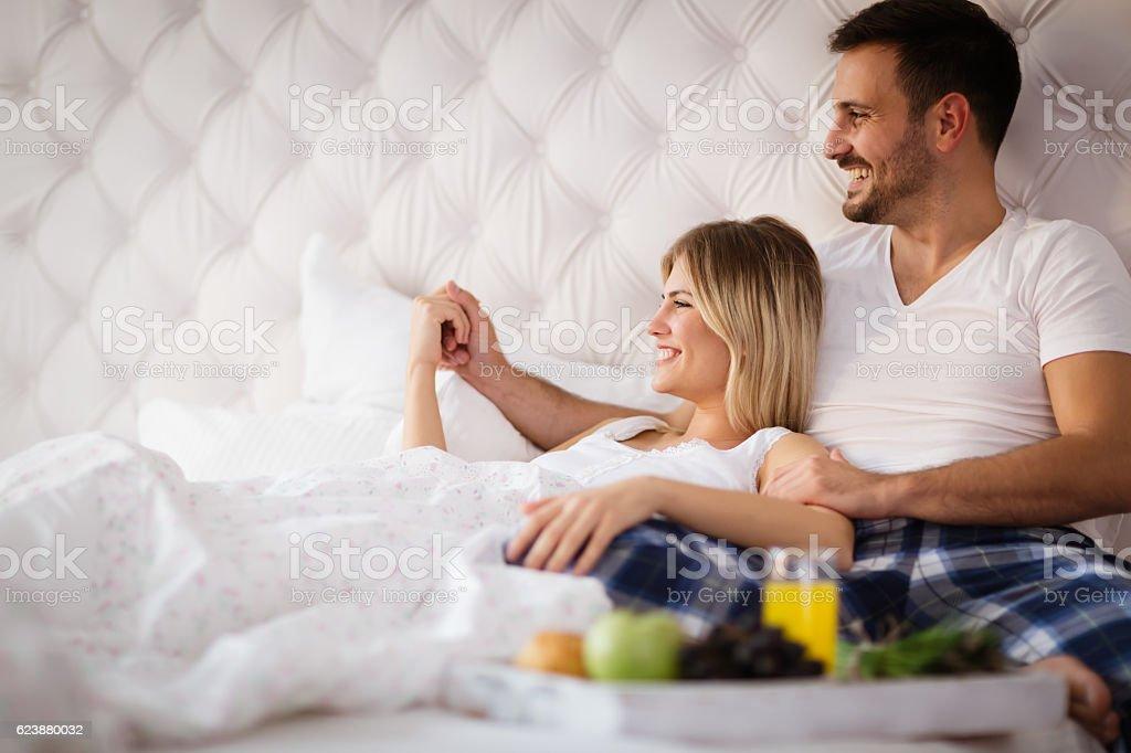 Romantic couple having breakfast in bed stock photo
