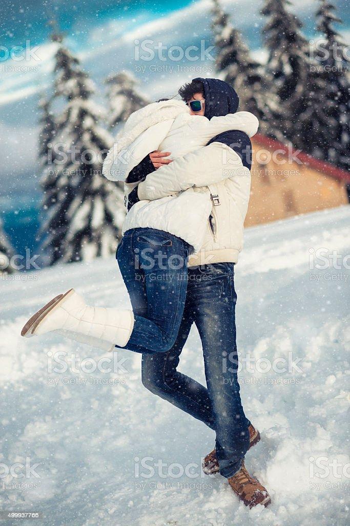 Romantic Couple Having Fun and Hugging on the Snow stock photo