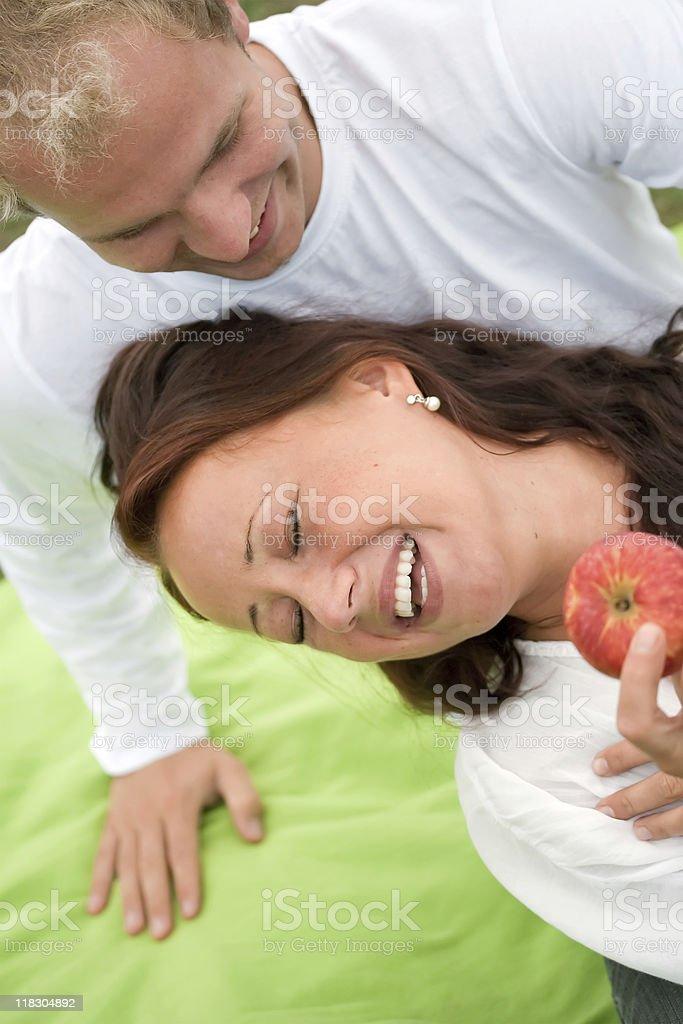 Romantic couple having fun on picnic royalty-free stock photo