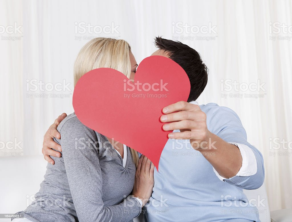 Romantic couple holding a red heart royalty-free stock photo