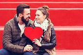 Romantic couple holding heart