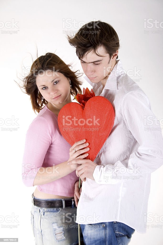 Romantic couple holding red heart royalty-free stock photo
