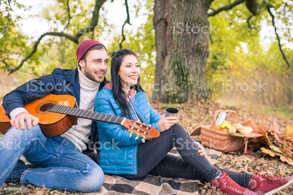 Romantic couple in autumn forest stock photo