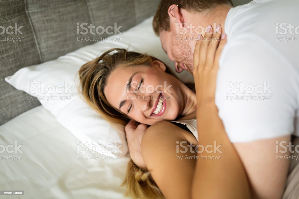 Romantic couple in bed being intimate royalty free stock photo. Romantic Couple In Bed Being Intimate stock photo 655814566   iStock