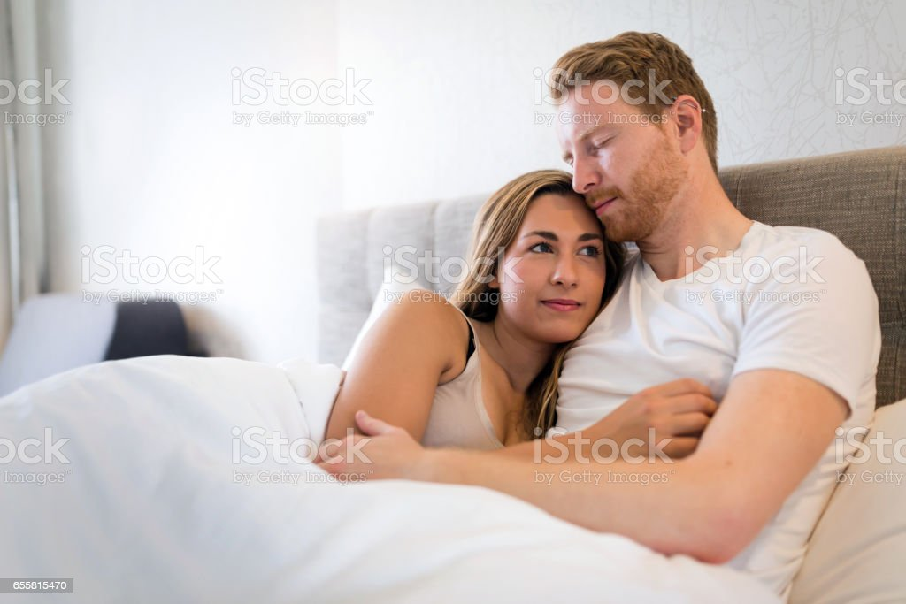 Romantic couple in bed being intimate royalty free stock photo. Romantic Couple In Bed Being Intimate stock photo 655815470   iStock