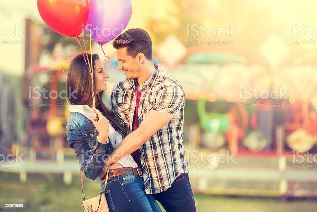 romantic couple in embrace looking at each other stock photo