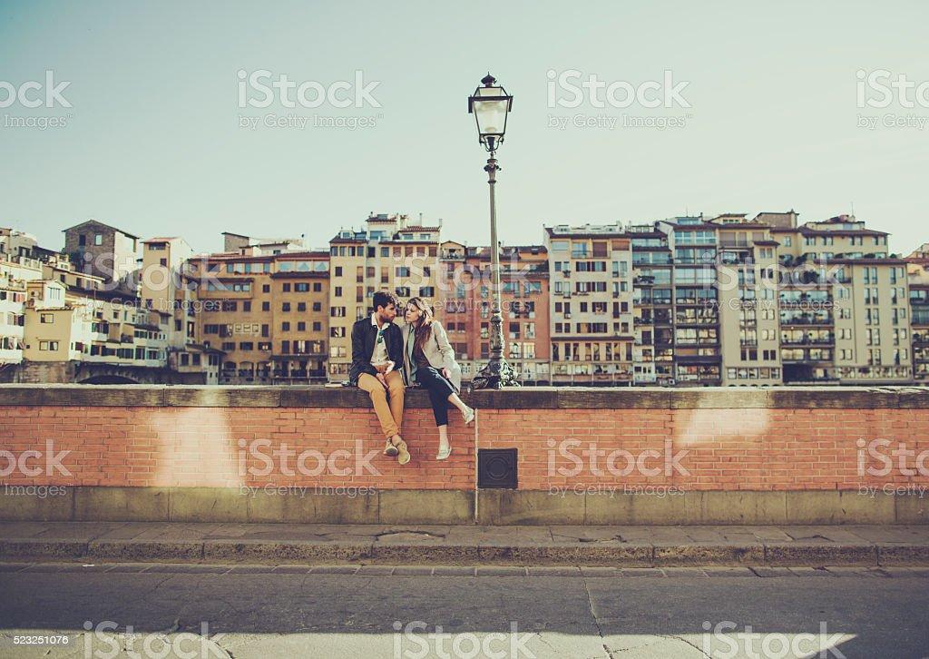 Romantic couple in Firenze near Ponte Vecchio stock photo