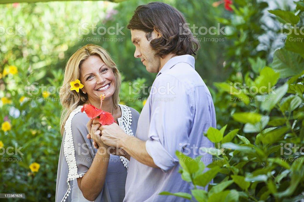 Romantic couple in garden stock photo