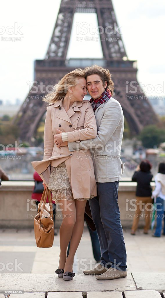 Romantic couple in Paris by the Eiffel Tower royalty-free stock photo