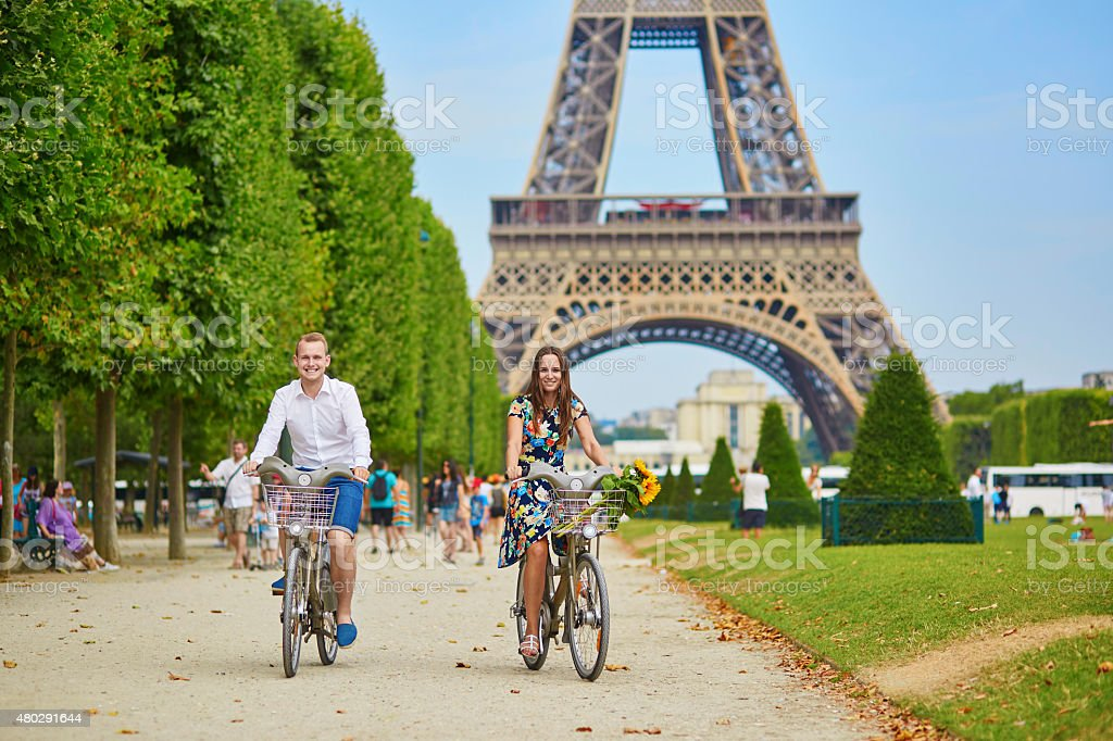 Romantic couple in Paris on a summer day stock photo