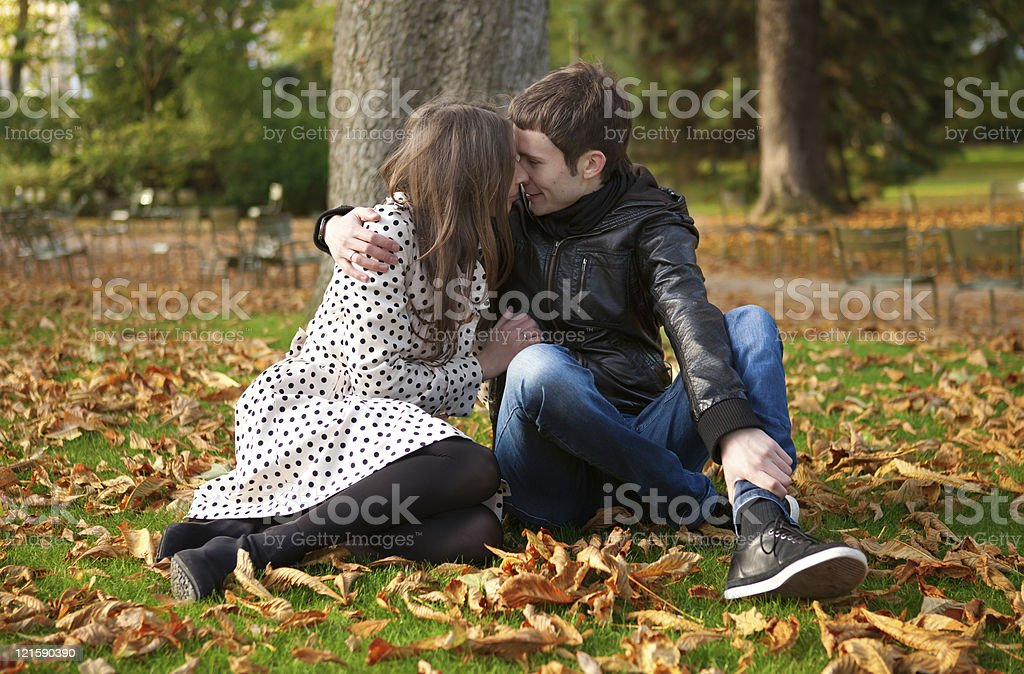Romantic couple in park at fall stock photo