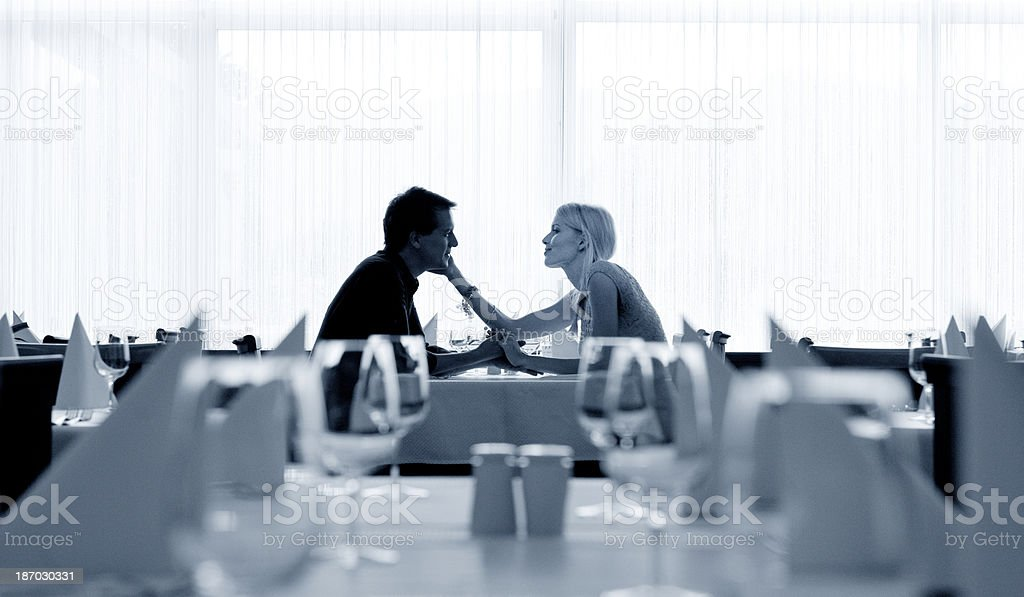 romantic couple in restaurant royalty-free stock photo
