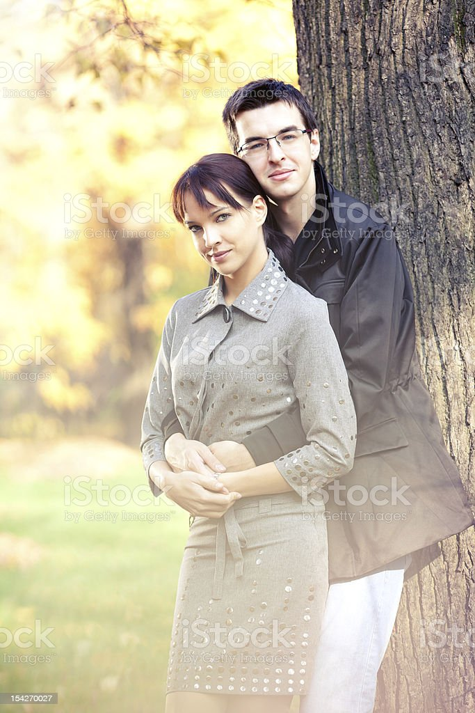 Romantic couple in the autumn park royalty-free stock photo