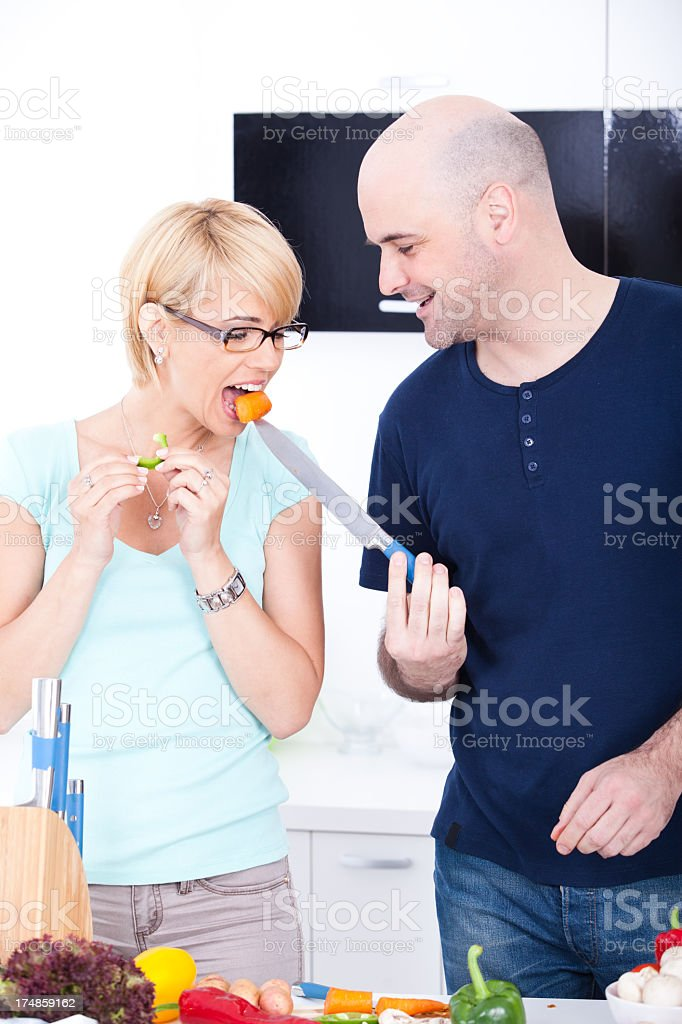 Romantic couple in the kitchen royalty-free stock photo