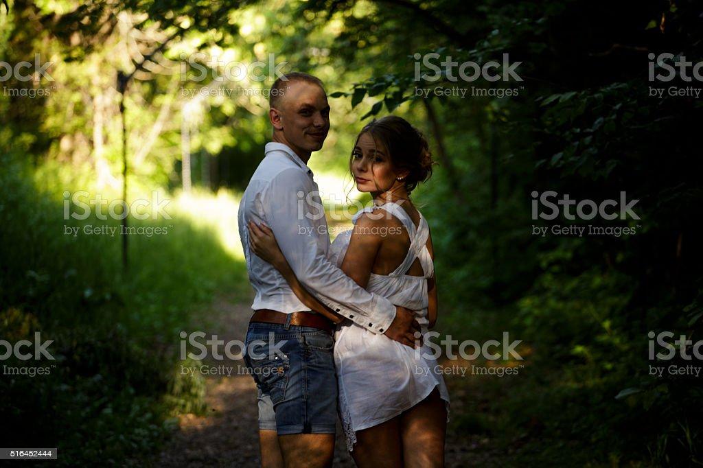 Romantic couple in the park stock photo