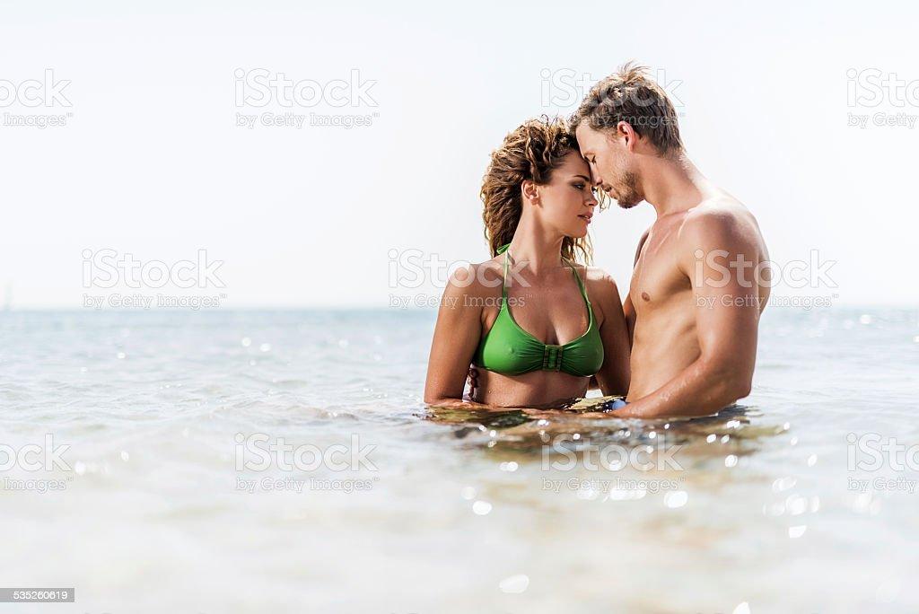 Romantic couple in the sea. stock photo