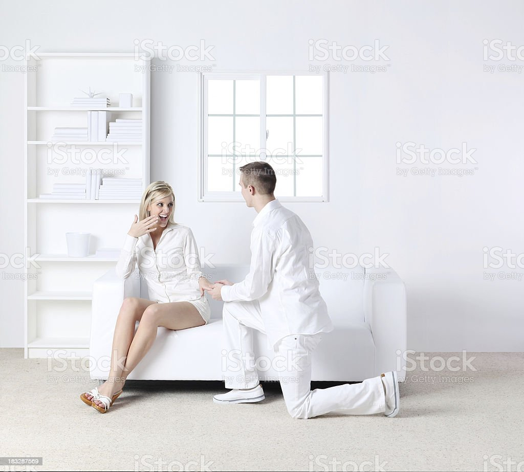 Romantic couple in white living room royalty-free stock photo