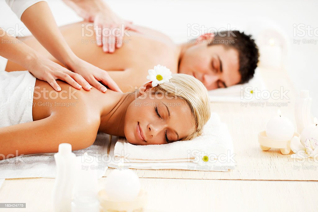 Romantic couple is having a back massage in spa center. royalty-free stock photo