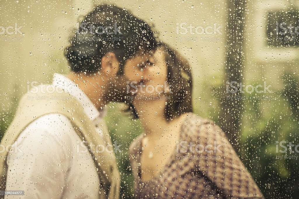 Romantic Couple Kissing Behind Wet Window royalty-free stock photo