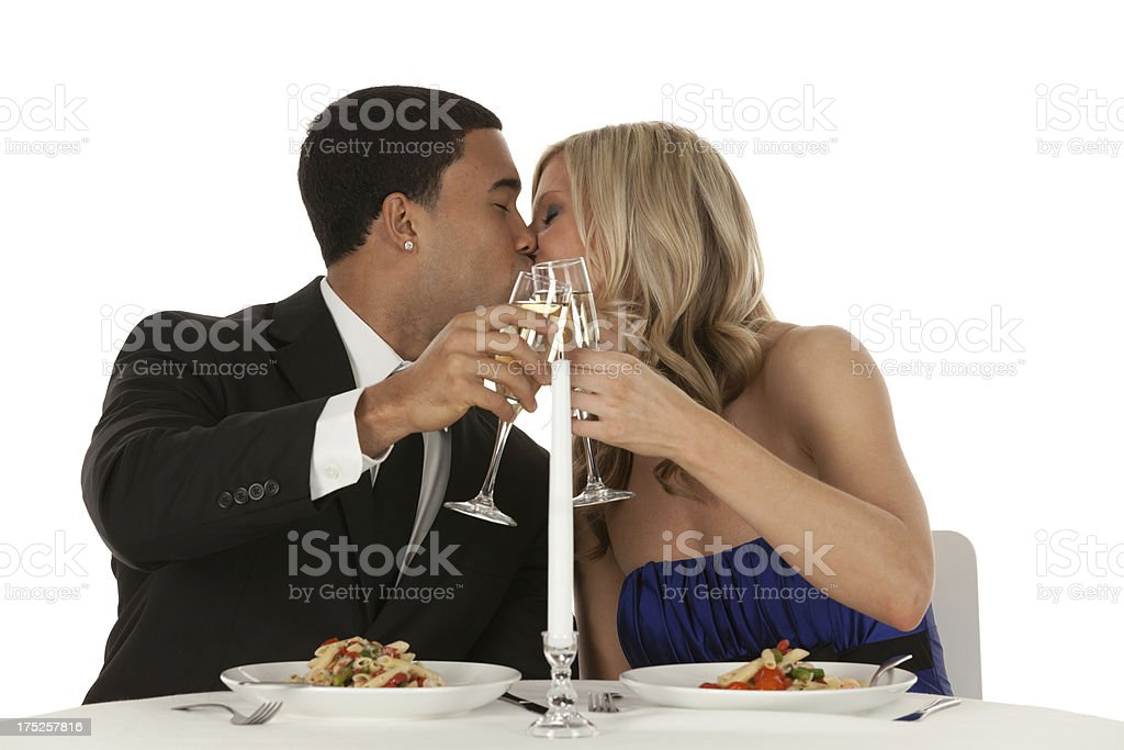 Romantic couple kissing each other at dining table royalty-free stock photo