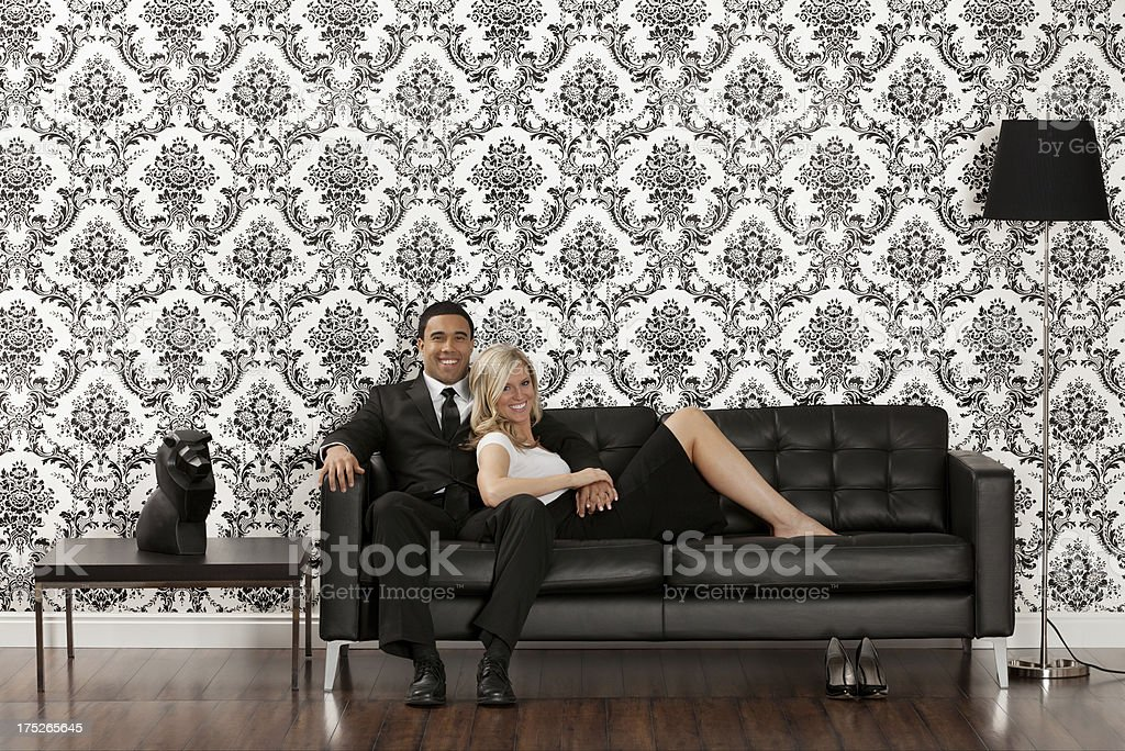 Romantic couple on a couch royalty-free stock photo
