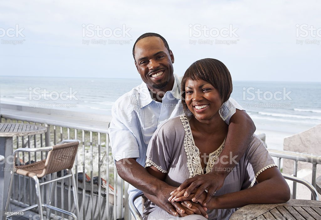 Romantic couple on beach terrace royalty-free stock photo