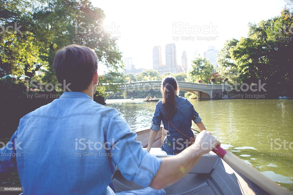 Romantic couple on boat stock photo