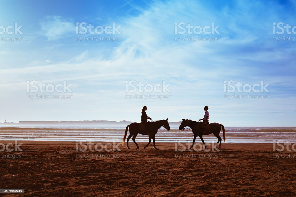 romantic couple on hourses stock photo