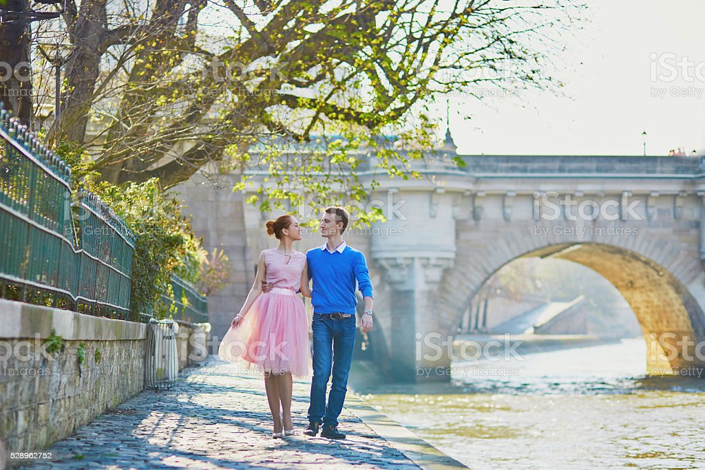Romantic couple on the Seine embankment in Paris stock photo