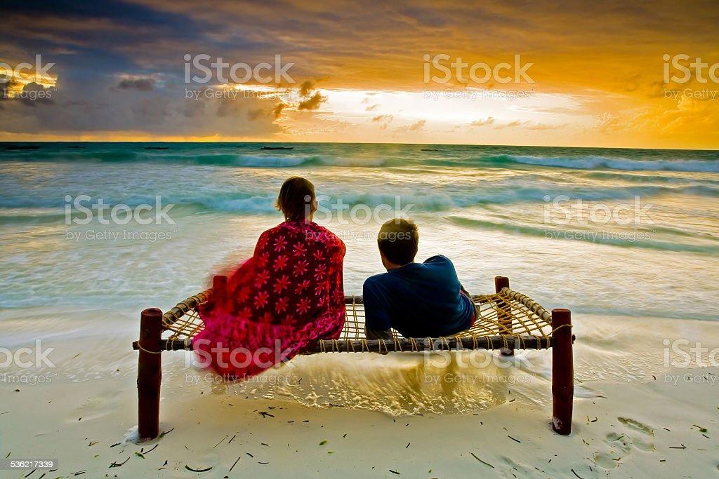 Romantic couple on tropical beach stock photo