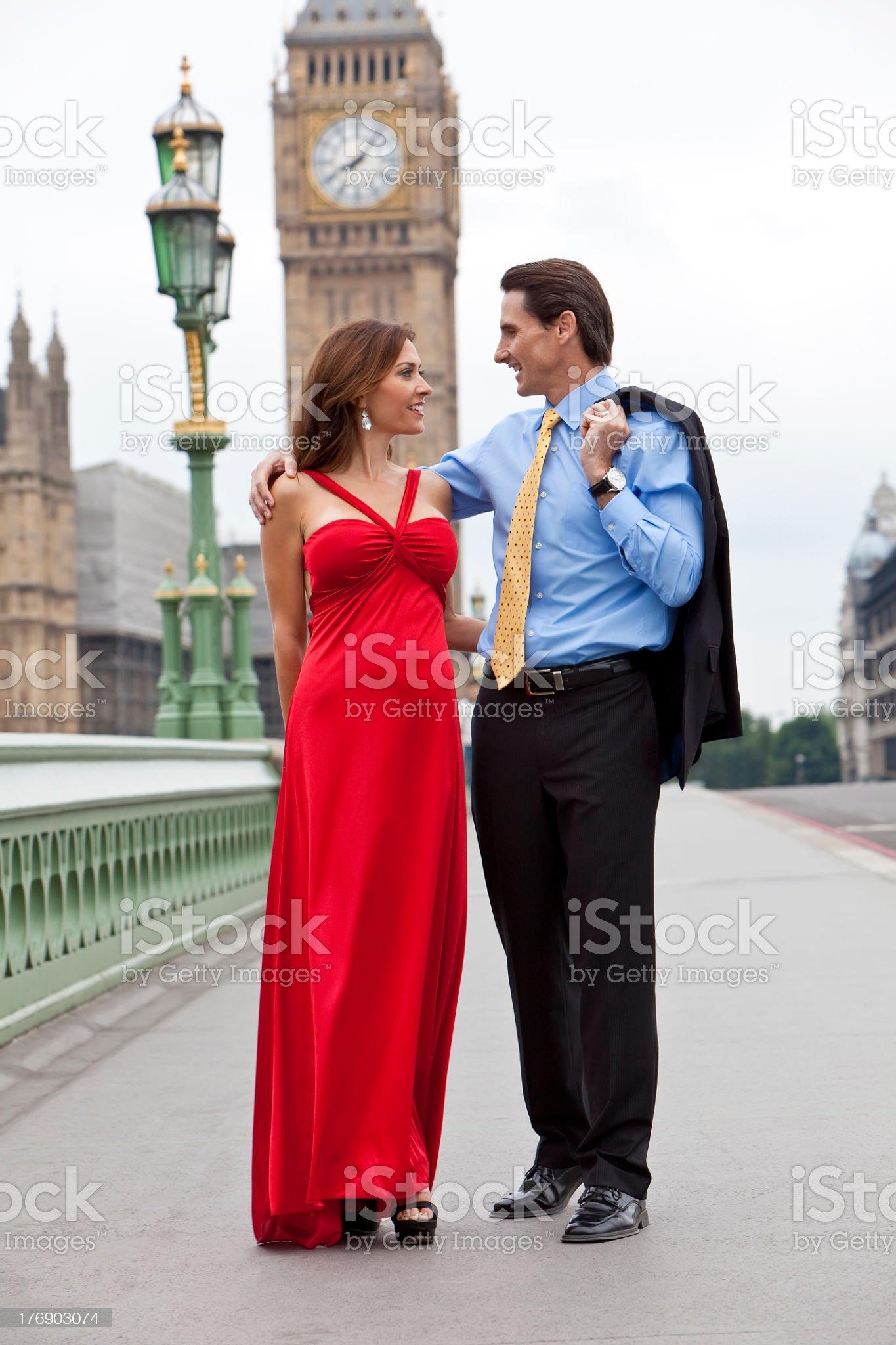 Romantic Couple on Westminster Bridge by Big Ben, London, England royalty-free stock photo