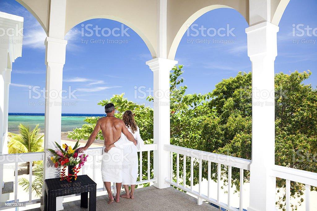Romantic couple overlooking Caribbean Sea royalty-free stock photo