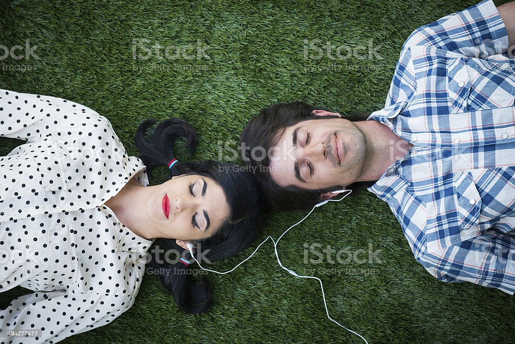 Romantic Couple Sharing Ear Buds stock photo
