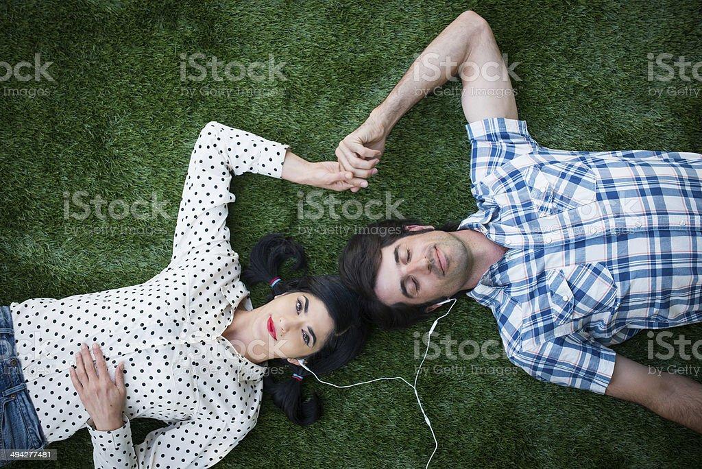 Romantic Couple Sharing Ear Buds stock photo