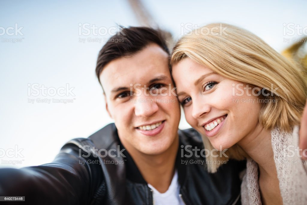 romantic couple take a selfie in paris stock photo