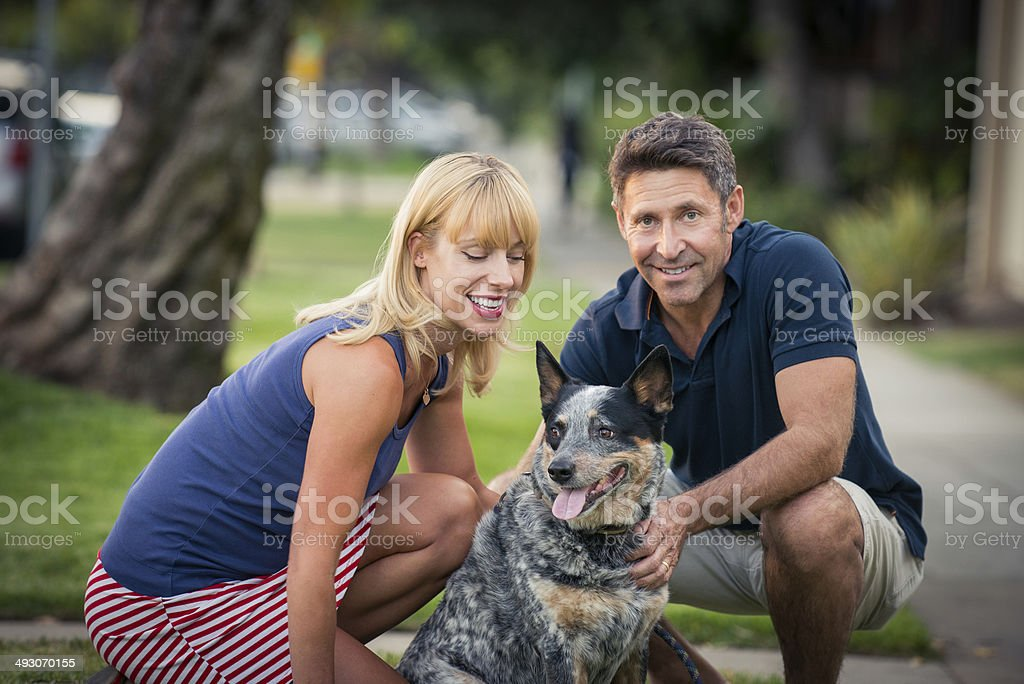 Romantic Couple Wallking The Dog stock photo