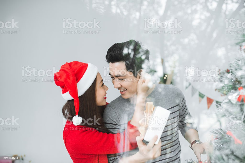 Romantic couple with christmas gift stock photo