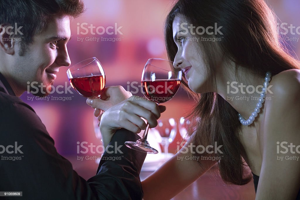 Romantic couple with glasses of wine in restaurant royalty-free stock photo