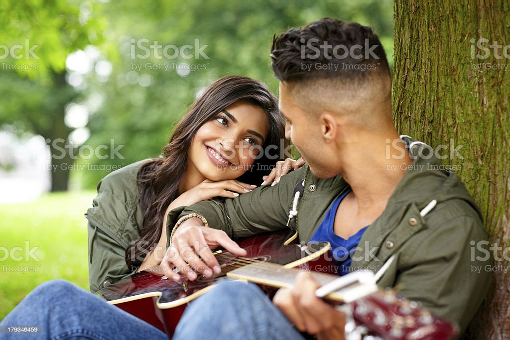 Romantic couple with guitar outdoors royalty-free stock photo