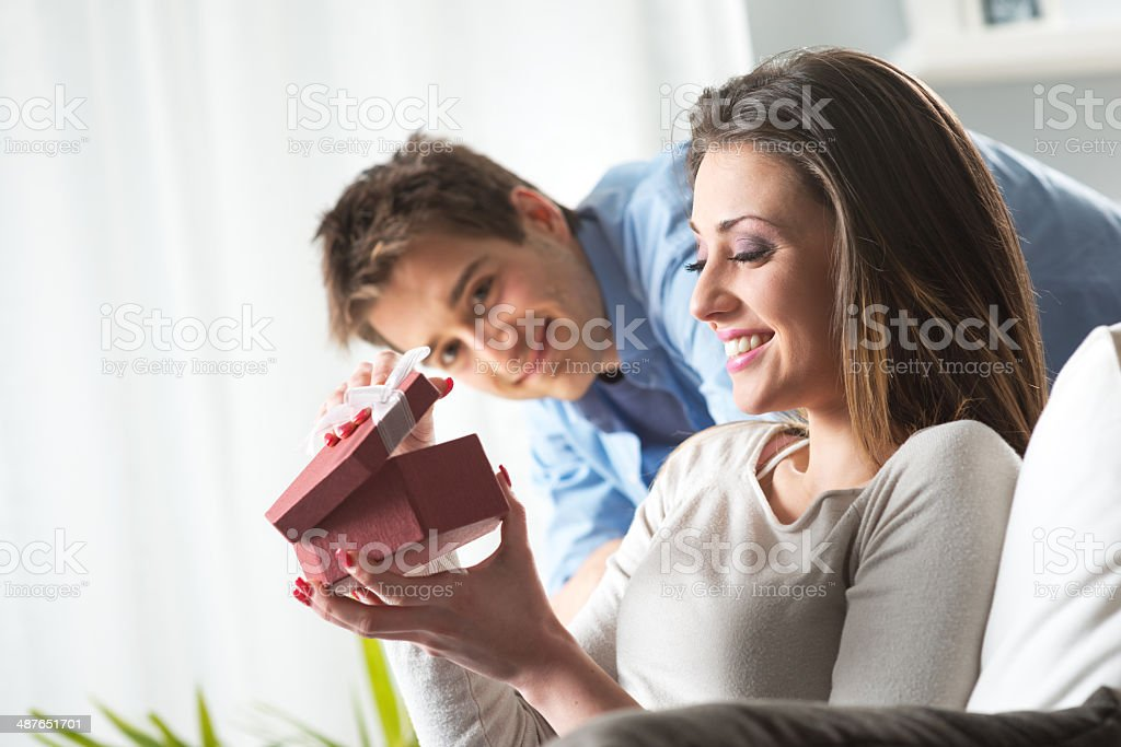 Romantic couple with present stock photo